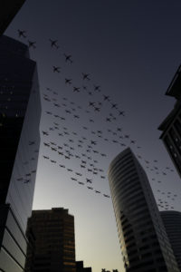 Montage of Planes taking off in the sky over skyscrapers